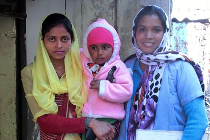 photo of health promoter, child and mother