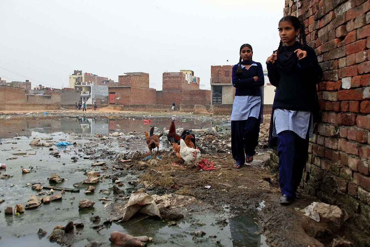 Across the basti, poor drainage leads to open waters contaminated with many kinds of waste.